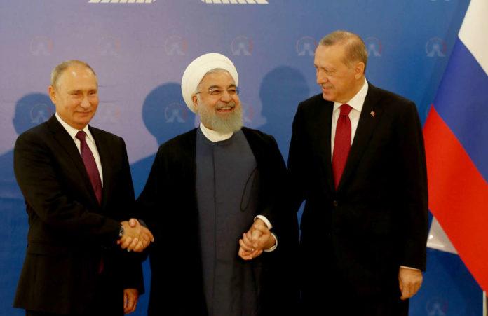 Während Putin, Rohani und Erdogan verhandelten, schlugen in Idlib schon Bomben ein.