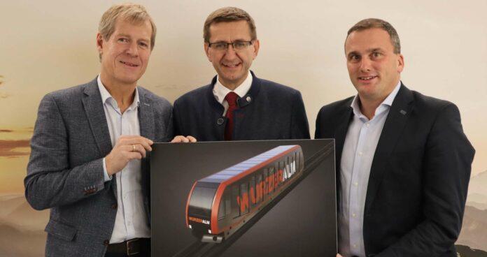 (v. l.): Holzinger, Wirtschafts-Landesrat Markus Achleitner und Rainer Rohregger (Co-Vorstand der Hinterstoder Wurzeralm Bergbahnen AG)