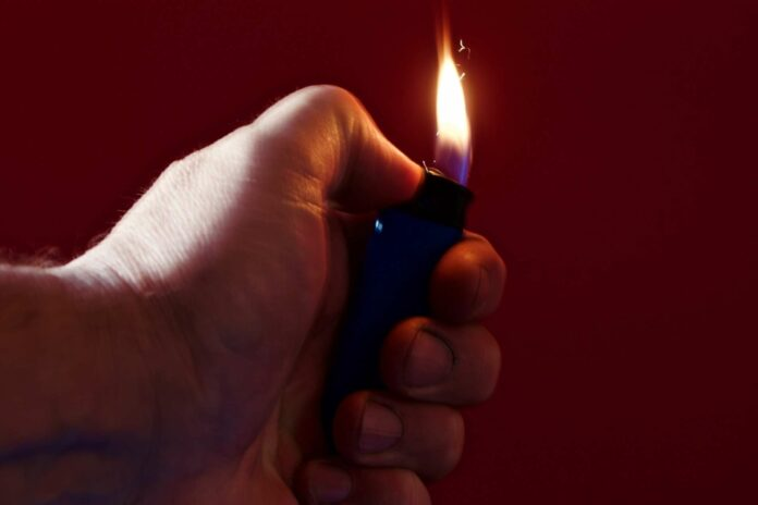 lighter in the hand of an arsonist